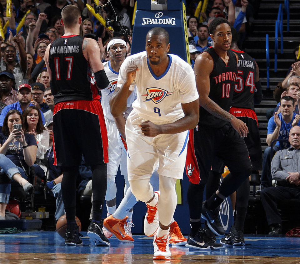Photo - Oklahoma City's Serge Ibaka (9) celebrates a basket during the NBA game between the Oklahoma City Thunder and the Toronto Raptors at the  Chesapeake Energy Arena in Oklahoma City, Sunday, March 8, 2015. Photo by Sarah Phipps, The Oklahoman