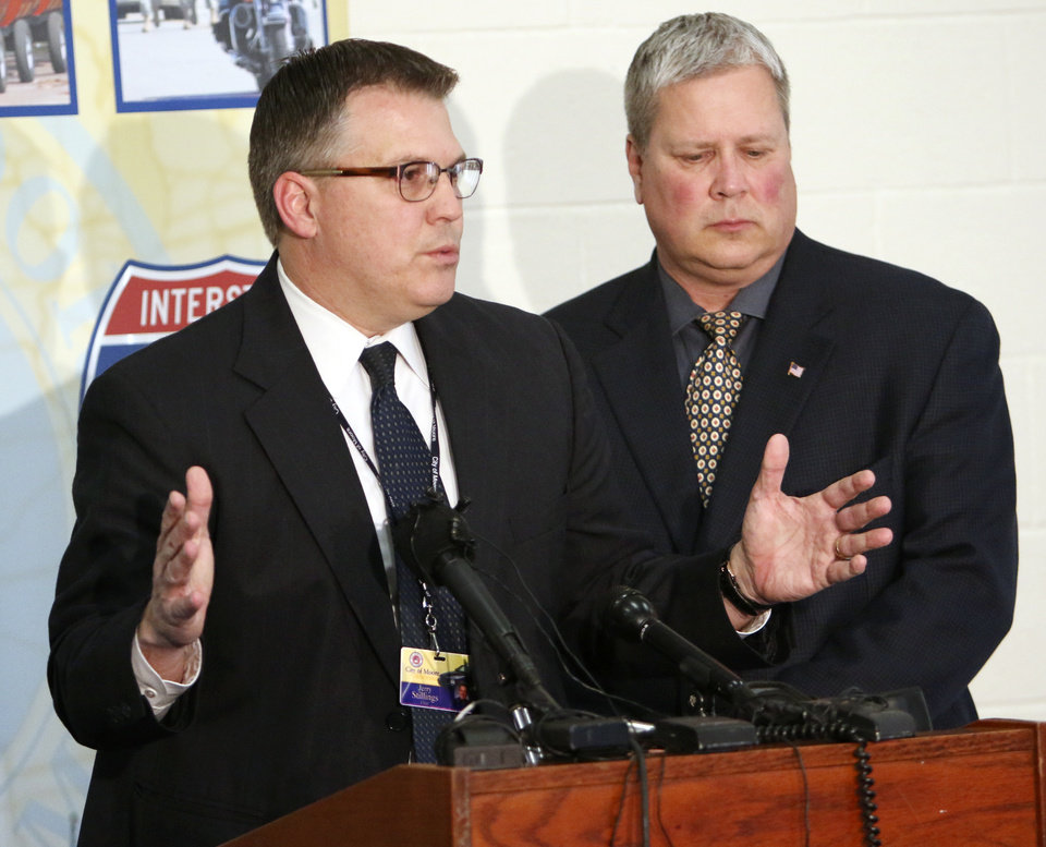 Photo - Moore Police Chief Jerry Stillings, left, and Assistant Chief Todd Strickland talk with members of the media about Luis Rodriguez's death in Moore, Tuesday February 18, 2014. Mr. Rodriguez died after an altercation with officers Saturday morning in the parking lot of the Warren Theatres.  Photo By Steve Gooch, The Oklahoman