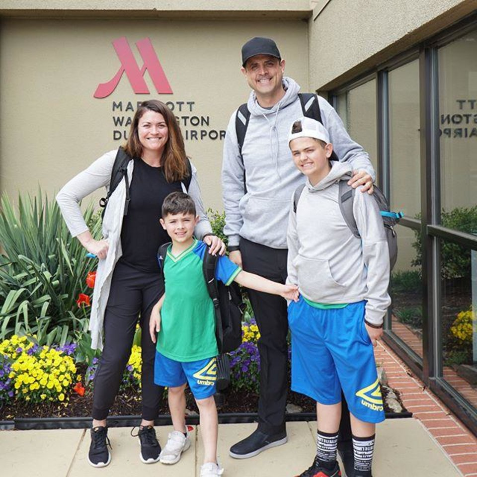 Photo - Saxum CEO Renzi Stone, with his wife Lee Anne and sons Walker and Jackson stopped for a photo on the first leg of their trip around the world.