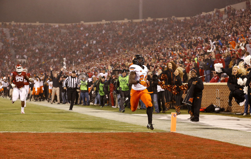 Photo - Oklahoma State's Tyreek Hill (24) runs a punt back to tie the game during the Bedlam college football game between the University of Oklahoma Sooners (OU) and the Oklahoma State Cowboys (OSU) at Gaylord Family-Oklahoma Memorial Stadium in Norman, Okla., Saturday, Dec. 6, 2014. Photo by Sarah Phipps, The Oklahoman