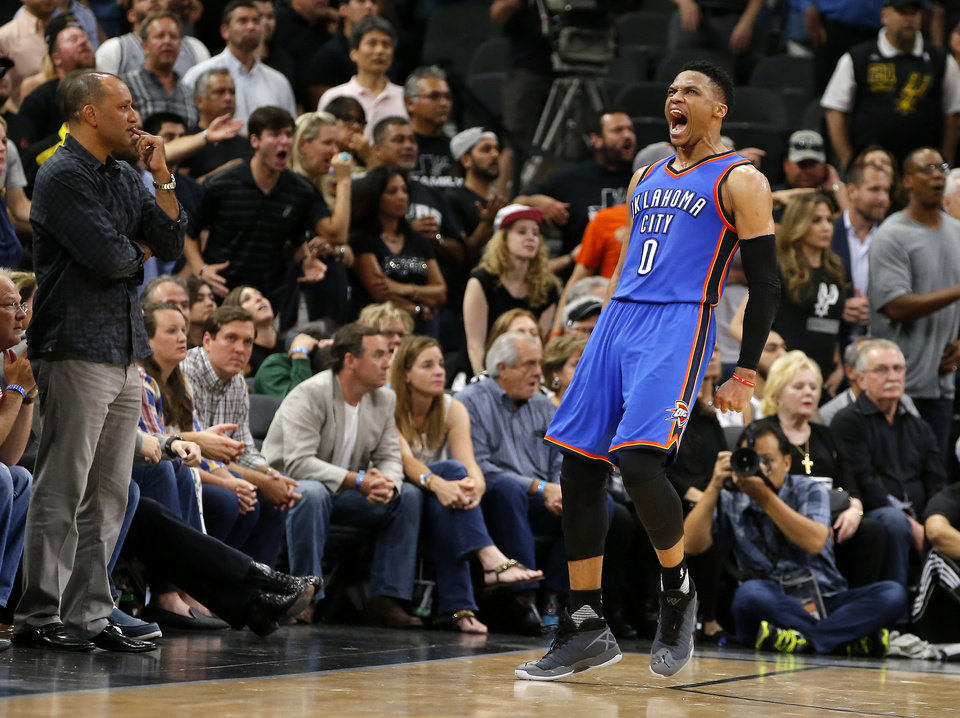 Photo -  Oklahoma City's Russell Westbrook (0) celebrates after a basket and a foul in the final seconds in Game 5 of the second-round series between the Oklahoma City Thunder and the San Antonio Spurs in the NBA playoffs at the AT&T Center in San Antonio, Tuesday, May 10, 2016. Oklahoma City won 95-91. Photo by Bryan Terry, The Oklahoman