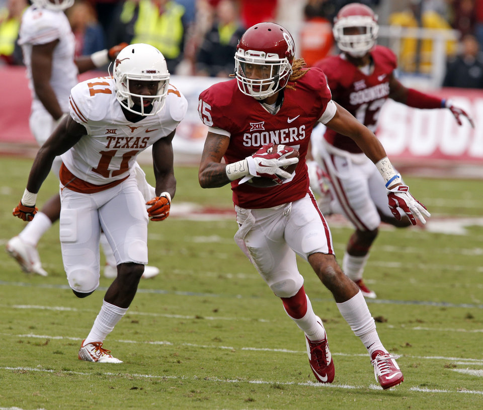 Photo - Oklahoma's Zack Sanchez (15) intercepts a pass and returns it for a score during the Red River Showdown college football game between the University of Oklahoma Sooners (OU) and the University of Texas Longhorns (UT) at the Cotton Bowl in Dallas, Texas on Saturday, Oct. 11, 2014. 