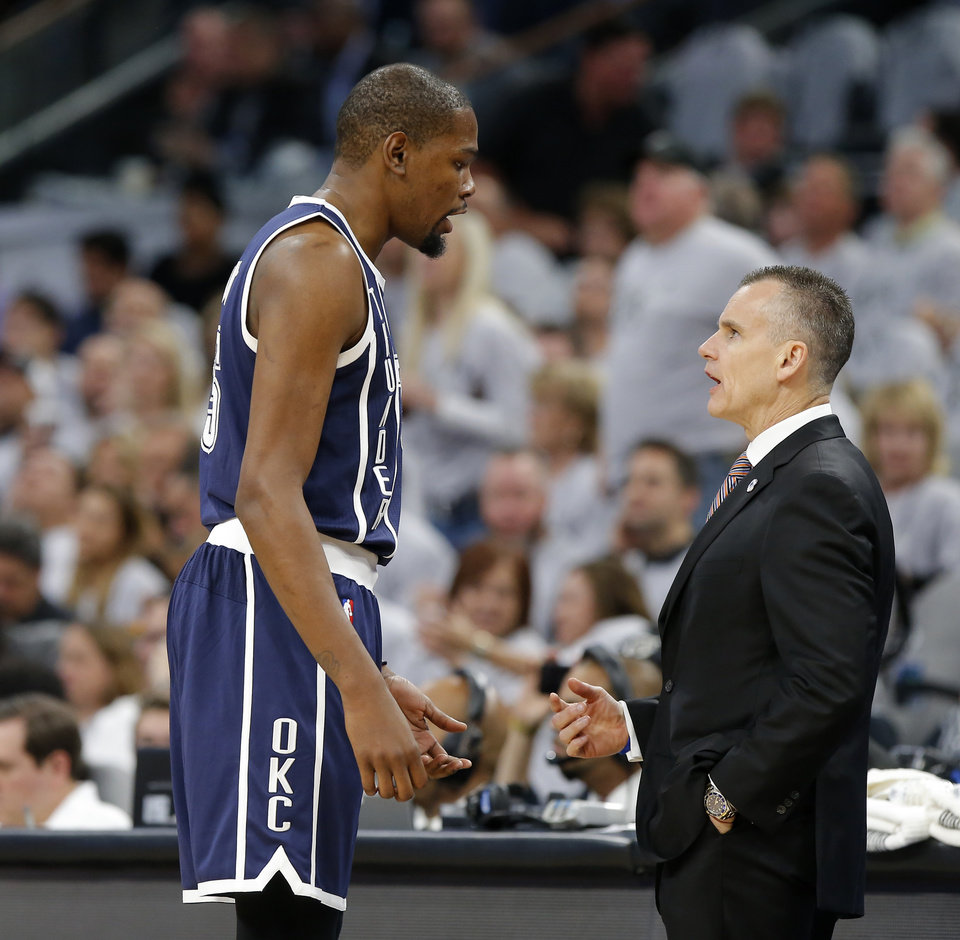 Photo - Oklahoma City's Kevin Durant (35) talks with coach Billy Donovan during Game 1 of the second-round series between the Oklahoma City Thunder and the San Antonio Spurs in the NBA playoffs at the AT&T Center in San Antonio, Saturday, April 30, 2016. San Antonio won 124-92. Photo by Bryan Terry, The Oklahoman