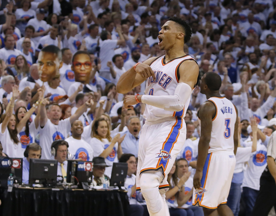 Photo - Oklahoma City's Russell Westbrook (0) celebrates after making a basket during Game 4 of the Western Conference finals in the NBA playoffs between the Oklahoma City Thunder and the Golden State Warriors at Chesapeake Energy Arena in Oklahoma City, Tuesday, May 24, 2016. Oklahoma City won 133-105. Oklahoma City won 118-94.  Photo by Bryan Terry, The Oklahoman