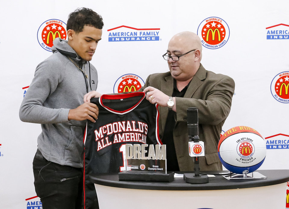 3a4ce4b4b402 Norman North senior basketball standout Trae Young receives his honorary McDonald s  All-America jersey Monday from Michael Hom of McDonald s in the Norman ...
