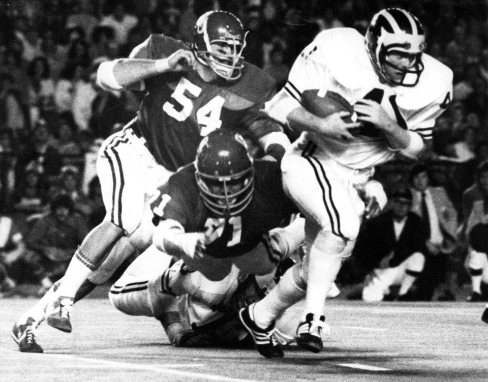 Photo - UNIVERSITY OF OKLAHOMA / COLLEGE FOOTBALL: Sooner defensive end Jimbo Elrod (54) pursues Michigan fullback Rob Lytle (41) during Thursday night action in Miami. The Sooners beat the Michigan Wolverines 14-6 in the Orange Bowl classic on 1/1/76. Staff photo via AP taken by Jim Argo on 1/1/76.  File:  Football/OU/OU-Michigan/Orange Bowl/Jimbo Elrod/1976