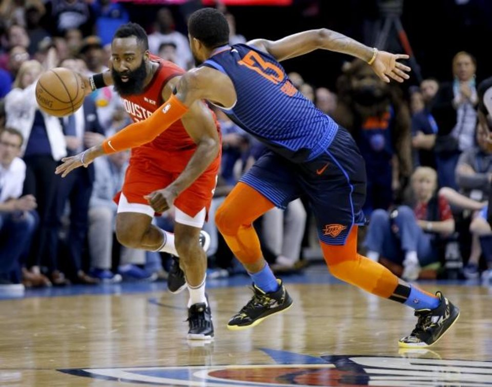 Photo -  Houston's James Harden (13) looks to get by Oklahoma City's Paul George (13) during the Thunder's 112-111 win Tuesday. [Sarah Phipps/The Oklahoman]