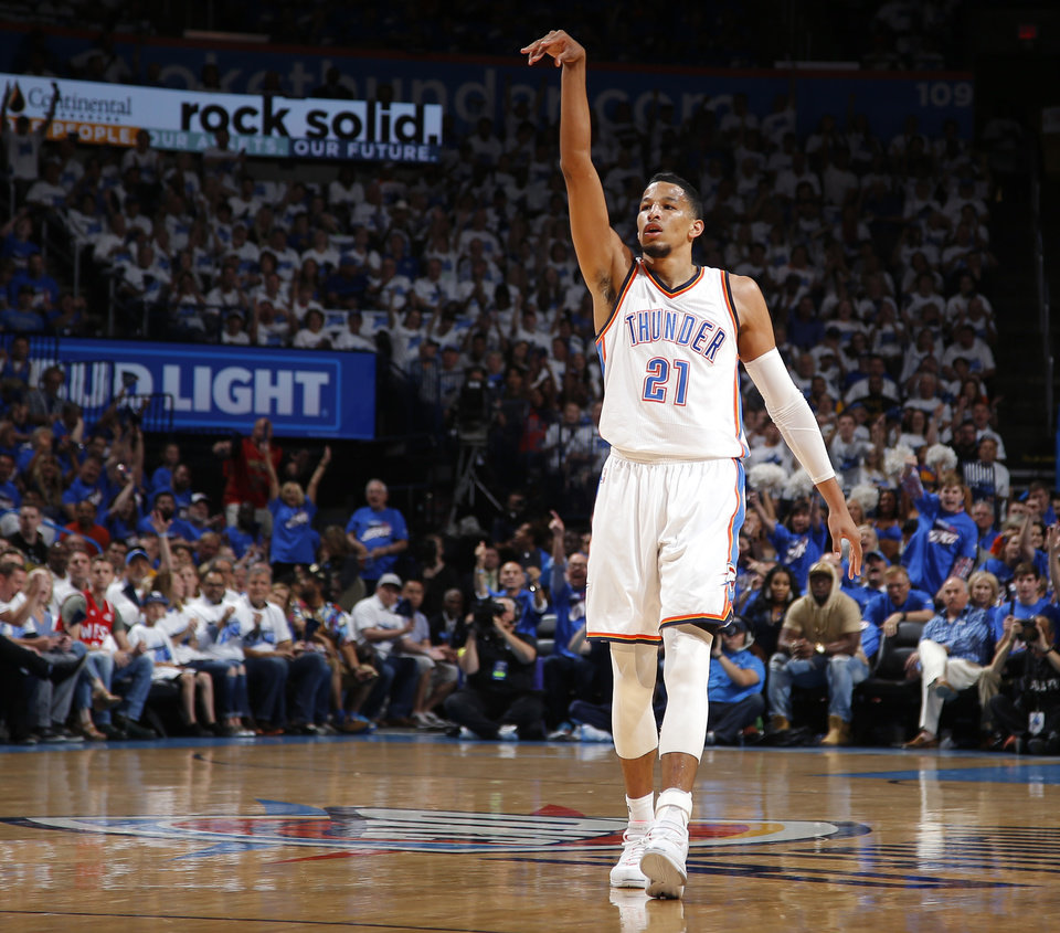 Photo - Oklahoma City's Andre Roberson (21) watches his shot go in during Game 3 of the Western Conference finals in the NBA playoffs between the Oklahoma City Thunder and the Golden State Warriors at Chesapeake Energy Arena in Oklahoma City, Sunday, May 22, 2016. Oklahoma City won 133-105. Photo by Bryan Terry, The Oklahoman