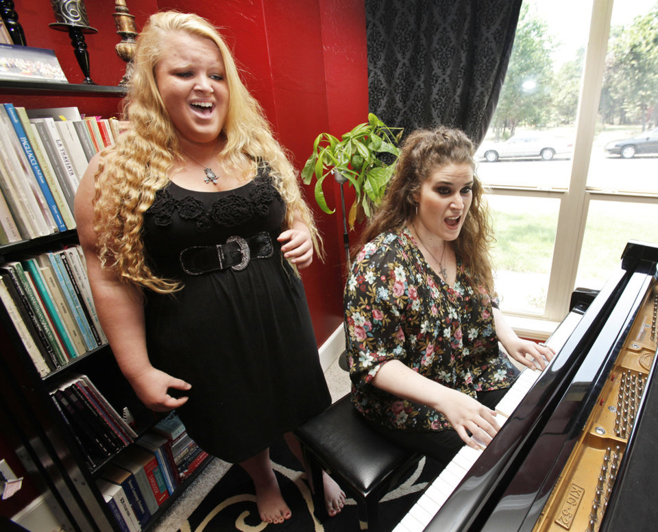 Photo - Morgan Tracy sings with voice teacher Regina Grimaldi during an