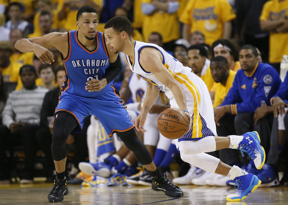 Photo - Golden State's Stephen Curry (30) goes past Oklahoma City's Andre Roberson (21) during Game 5 of the Western Conference finals in the NBA playoffs between the Oklahoma City Thunder and the Golden State Warriors at Oracle Arena in Oakland, Calif., Thursday, May 26, 2016. Photo by Nate Billings, The Oklahoman