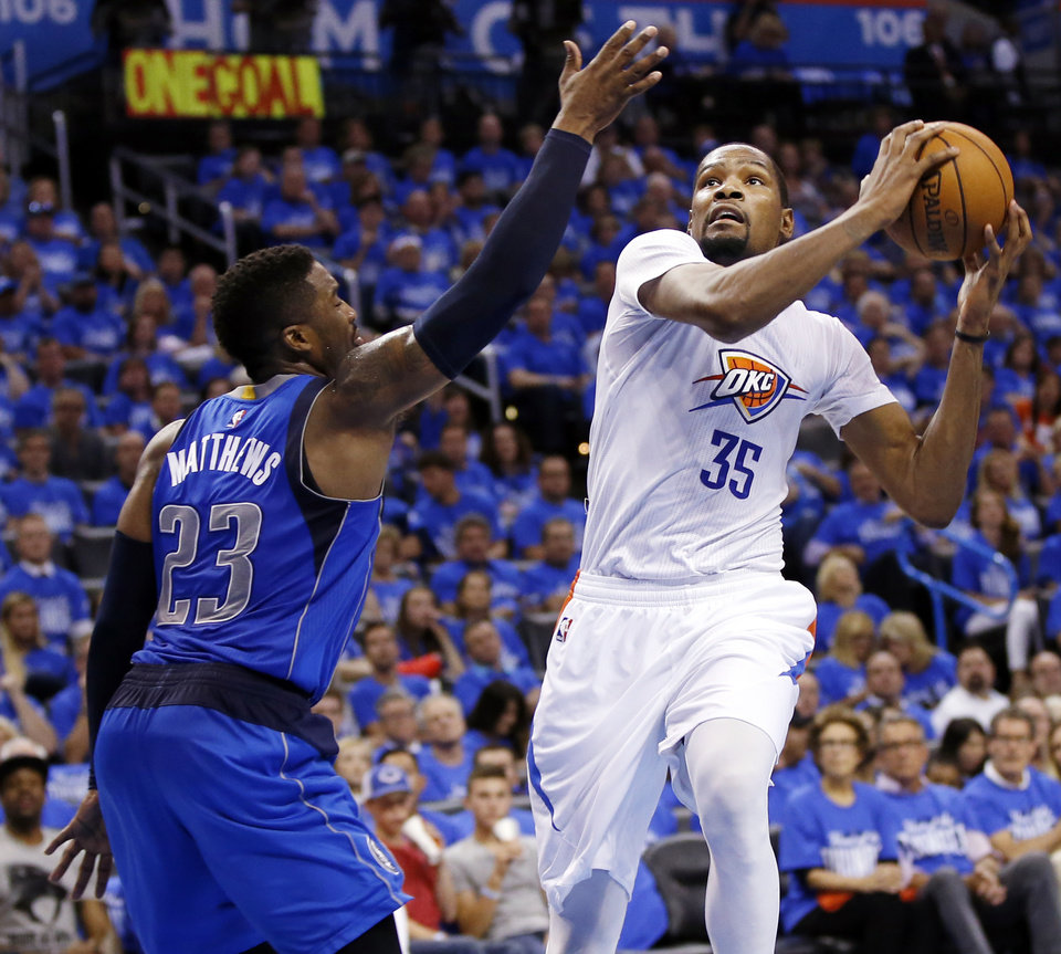 Photo - Oklahoma City's Kevin Durant, right, said the Thunder and San Antonio Spurs have had some playoff battles over the years. (Photo by Nate Billings, The Oklahoman)