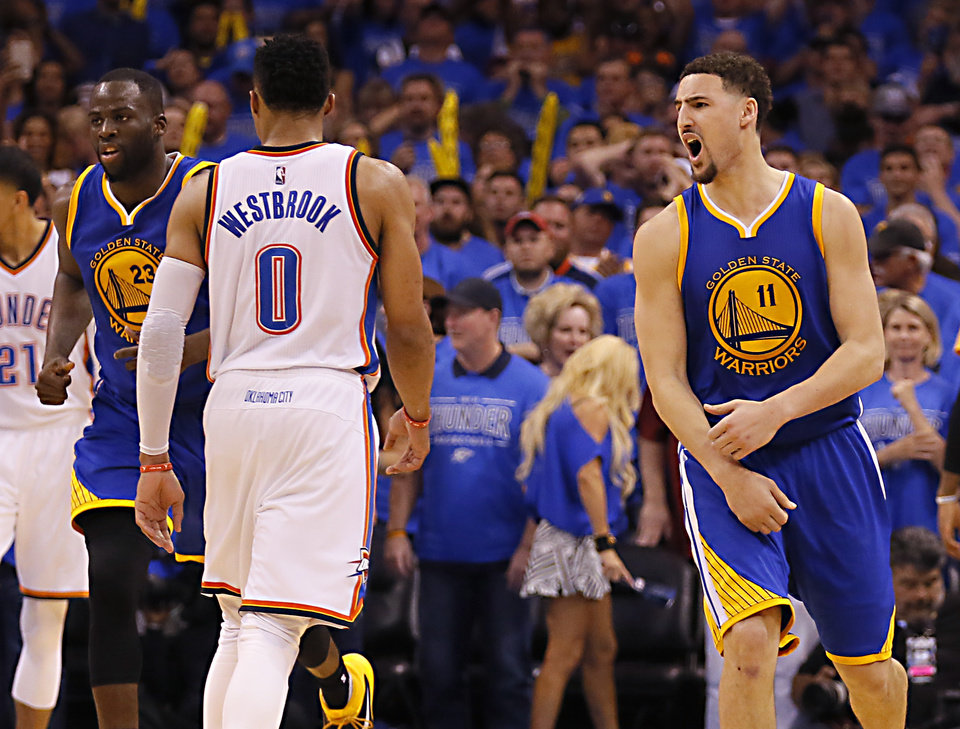 Photo - Golden State's Klay Thompson (11) celebrates his 3-point basket next to Oklahoma City's Russell Westbrook (0) late in the 4th quarter during Game 6 of the Western Conference finals in the NBA playoffs between the Oklahoma City Thunder and the Golden State Warriors at Chesapeake Energy Arena in Oklahoma City, Saturday, May 28, 2016. Photo by Sarah Phipps, The Oklahoman