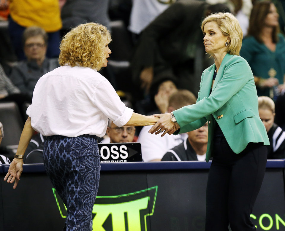 Photo - OU coach Sherri Coale, left, and Baylor coach Kim Mulkey shake hands after a semifinal game Sunday in the Big 12 Women's Basketball Championships at Chesapeake Energy Arena. Baylor won, 84-57. (Photo by Nate Billings, The Oklahoman)
