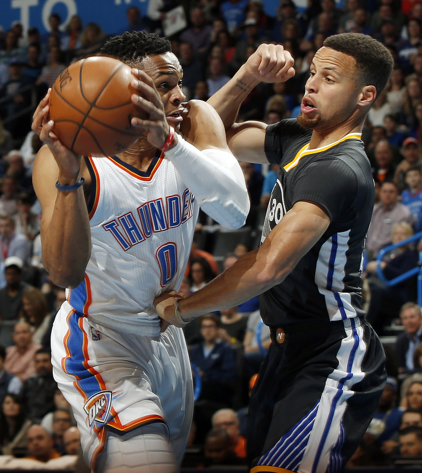 Photo - Oklahoma City's Russell Westbrook (0) tries to score against Golden State's Stephen Curry (30) during an NBA basketball game between the Oklahoma City Thunder and the Golden State Warriors at Chesapeake Energy Arena in Oklahoma City, Saturday, Feb. 27, 2016. Photo by Nate Billings, The Oklahoman