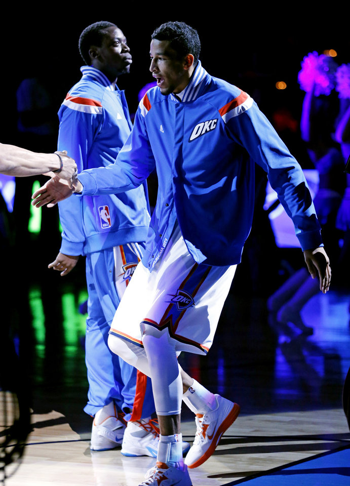 Photo - Thunder's Andre Roberson (21) is introduced as a starter before the NBA basketball game between the Oklahoma City Thunder and the New Orleans Pelicans at Chesapeake Energy Arena on Dec. 21, 2014 in Oklahoma City, Okla. Photo by Steve Sisney, The Oklahoman