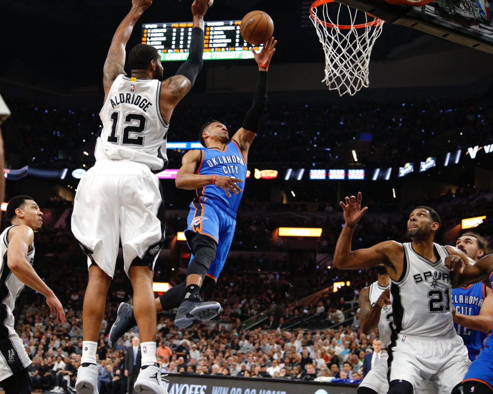 Photo - Oklahoma City's Russel Westbrook goes to the basket during Game 5 of the second-round series between the Oklahoma City Thunder and the San Antonio Spurs in the NBA playoffs at the AT&T Center in San Antonio, Tuesday, May 10, 2016. Photo by Bryan Terry, The Oklahoman
