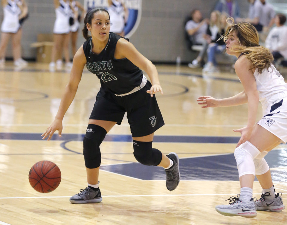 Photo - Norman North's Jacie Evans looks to get by Edmond North's Amaia Maxwell during the girls high school basketball game between Edmond North and Norman North at Edmond North High School in Edmond, Okla.,   Friday, Jan. 4, 2019. Photo by Sarah Phipps, The Oklahoman