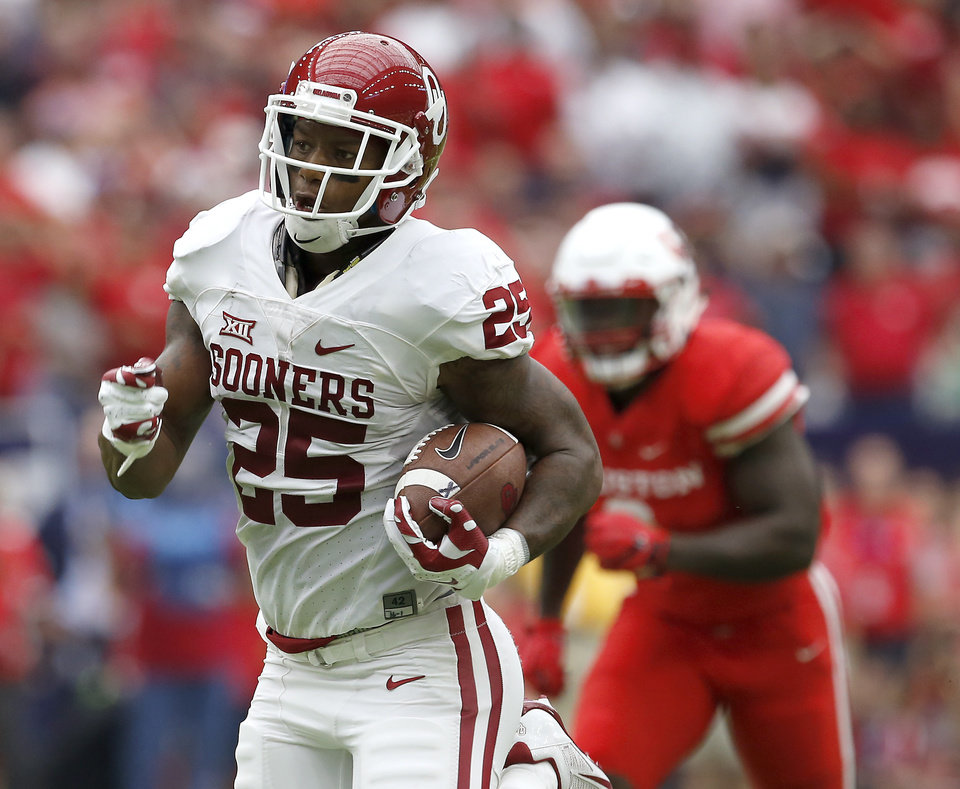 Photo - Oklahoma's Joe Mixon runs for a touchdown during the AdvoCare Texas Kickoff college football game between the Sooners and Houston Cougars at NRG Stadium in Houston on Saturday. Houston won 33-23. (Photo by Bryan Terry, The Oklahoman)