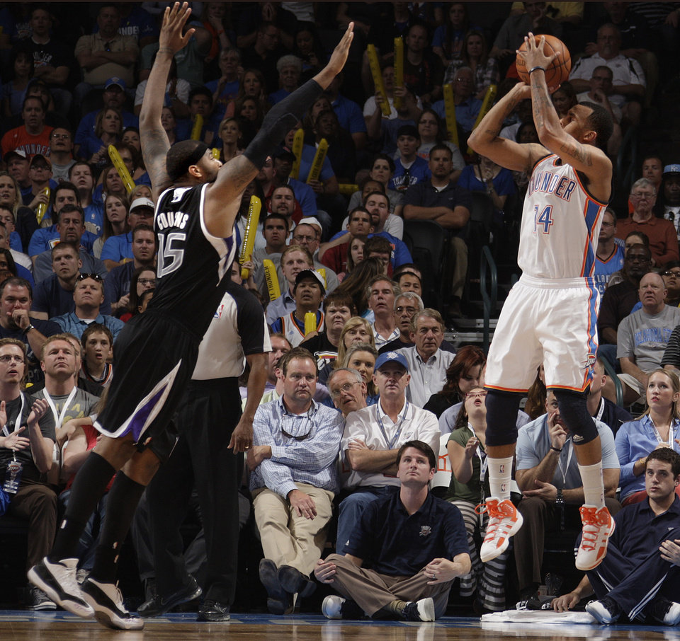 7074437d5d4 Oklahoma City s Daequan Cook (14) shoots a three-point shot as Sacramento s  DeMarcus Cousins (15) defends during the NBA basketball game between the ...