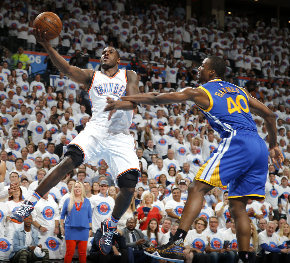 Photo - Oklahoma City's Dion Waiters (3) goes past Golden State's Harrison Barnes (40) during Game 4 of the Western Conference finals in the NBA playoffs between the Oklahoma City Thunder and the Golden State Warriors at Chesapeake Energy Arena in Oklahoma City, Tuesday, May 24, 2016. Oklahoma City won 118-94. Photo by Bryan Terry, The Oklahoman