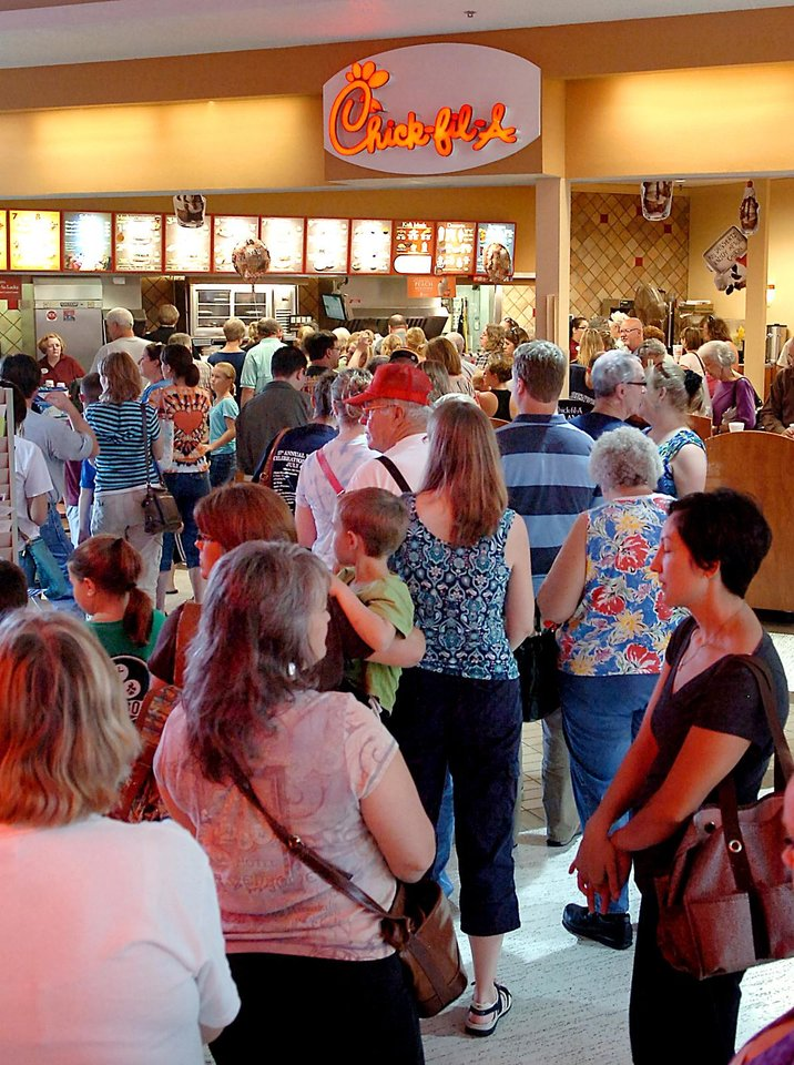 Photo - Chick-fil-A customers flood the location at Oakwood Mall Wednesday, Aug. 1, 2012, in Enid, Okla., to show support for the Christian-run company who supports traditional values and has voiced an open opposition to gay marriage. Chick-fil-A supporters are planning to eat at restaurants in the chicken chain as the company continues to be criticized for an executive's comments about marriage and family.  (AP Photo/Enid News & Eagle, Billy Hefton)