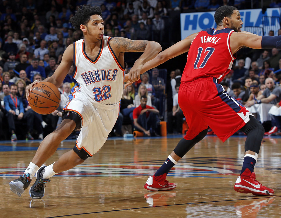 Photo -  Oklahoma City's Cameron Payne (22) dribbles past Washington's Garrett Temple (17) during an NBA basketball game between the Oklahoma City Thunder and the Washington Wizards at Chesapeake Energy Arena in Oklahoma City, Monday, Feb. 1, 2016. Photo by Nate Billings, The Oklahoman