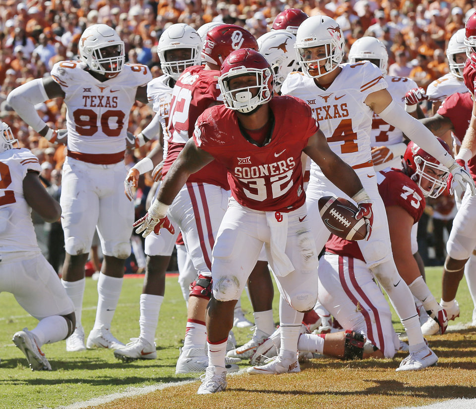 Photo - The resurgence of Oklahoma running back Samaje Perine is bringing up the question of whether he will return for another season or declare for the NFL Draft.  (Photo by Nate Billings, The Oklahoman)