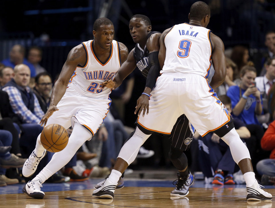 Photo - Oklahoma City's Dion Waiters (23) dribbles around a pick of Orlando's Victor Oladipo (5) by Oklahoma City's Serge Ibaka (9) during an NBA basketball game between the Oklahoma City Thunder and the Orlando Magic at Chesapeake Energy Arena in Oklahoma City, Monday, Feb. 2, 2015. Oklahoma City won 104-97. Photo by Nate Billings, The Oklahoman