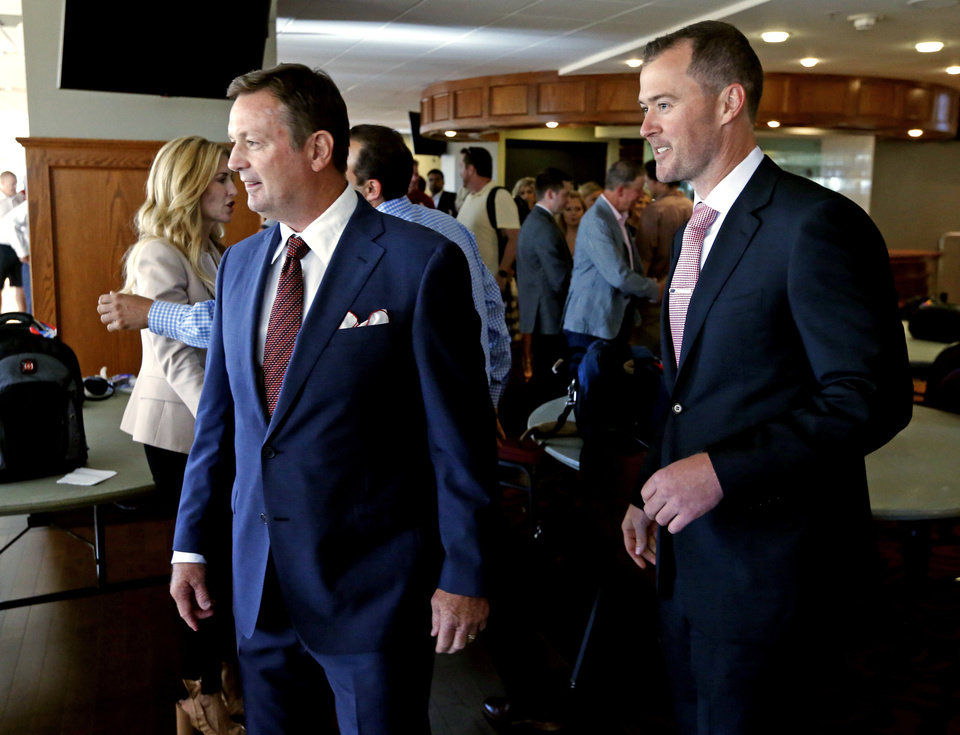Photo -  Bob Stoops and Lincoln Riley arrive for the news conference Wednesday that announced Stoops' retirement and Riley's elevation to head coach. [PHOTO BY STEVE SISNEY, THE OKLAHOMAN]