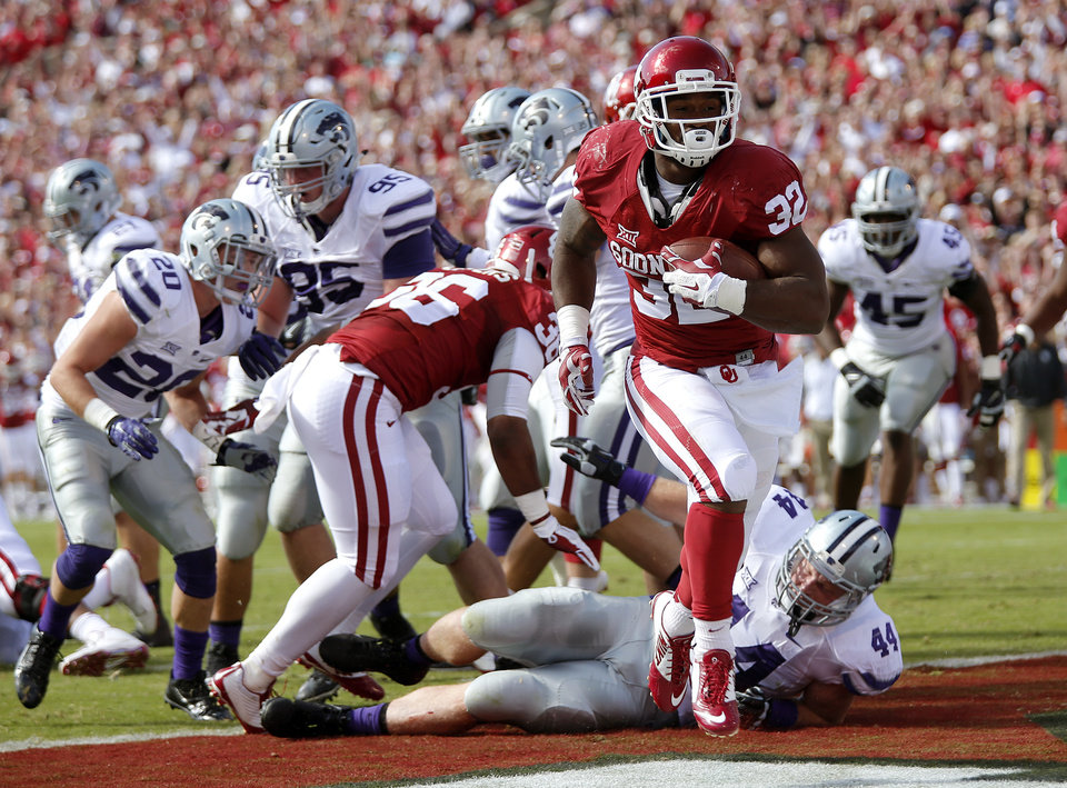 Photo - Oklahoma's Samaje Perine (32) scores a touchdown past Kansas State's Ryan Mueller (44) during the college football game between the University of Oklahoma Sooners (OU) and Kansas State University Wildcats (KSU) at Gaylord Family-Oklahoma Memorial Stadium in  Norman, Okla. on Saturday, Oct. 18, 2014. Photo by Chris Landsberger, The Oklahoman