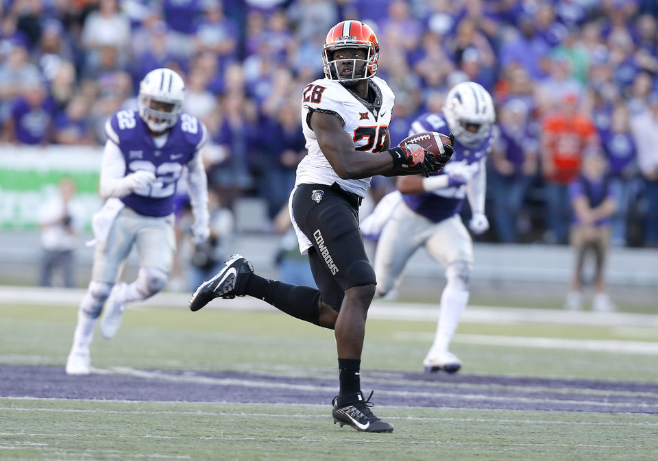 Photo -  OSU receiver James Washington (28) runs after a long reception for a touchdown against Kansas State in 2016. Washington caught three passes for at least 80 yards last season. [PHOTO BY SARAH PHIPPS, THE OKLAHOMAN]