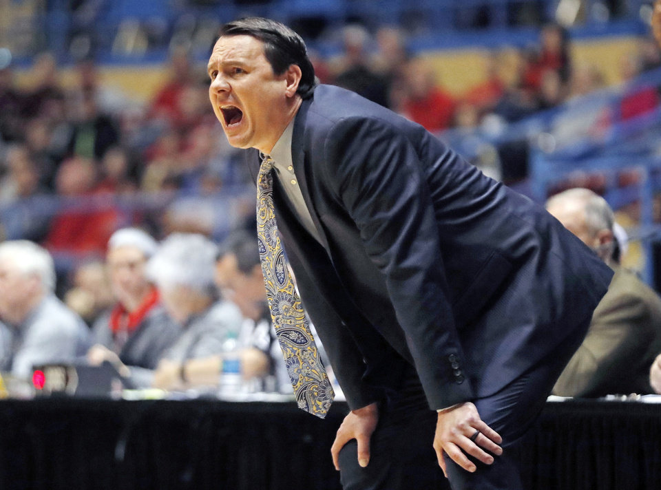 Photo - FILE - In this Dec. 15, 2018, file photo, Abilene Christian coach Joe Golding yells out at his players during the first half of an NCAA college basketball game against Texas Tech in Lubbock, Texas.  Golding hopes his team holds up better than his suit in the NCAA Tournament. He ripped his pants celebrating Abilene Christian's seeding Sunday night and wasn't able to get them repaired before leaving for Jacksonville, where the 15th-seeded Wildcats will face second-seeded Kentucky in the opening round Thursday. (AP Photo/Brad Tollefson, File)