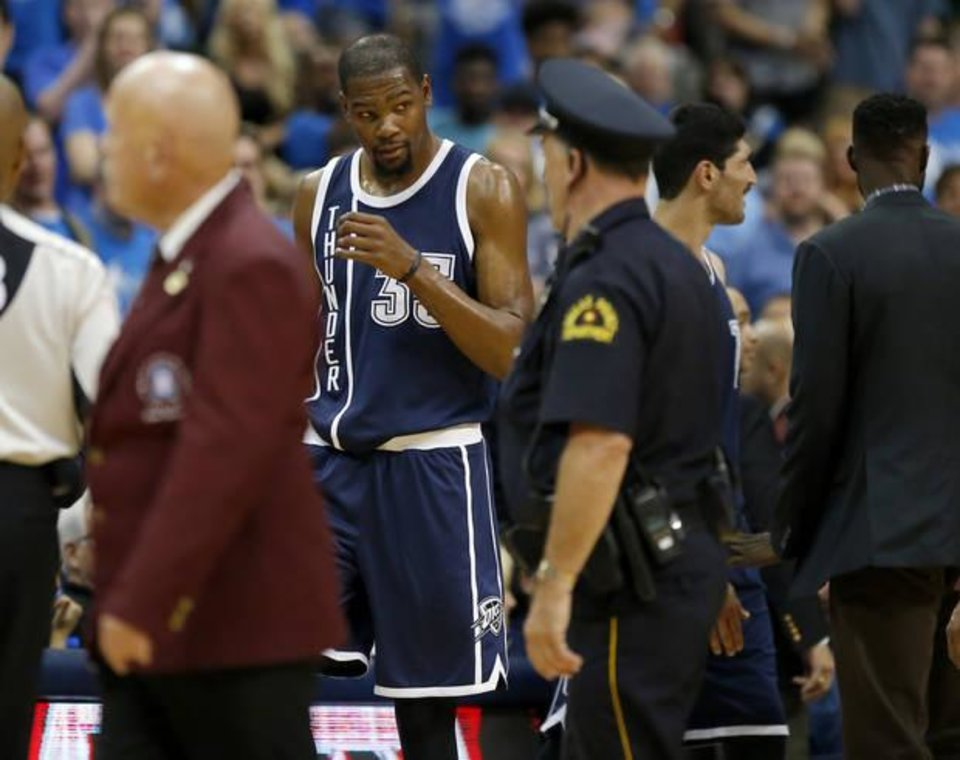 5e21146d5e17 Oklahoma City s Kevin Durant (35) walks towards the Dallas bench after  getting ejected during Game 4 of the first round series between the Oklahoma  City ...
