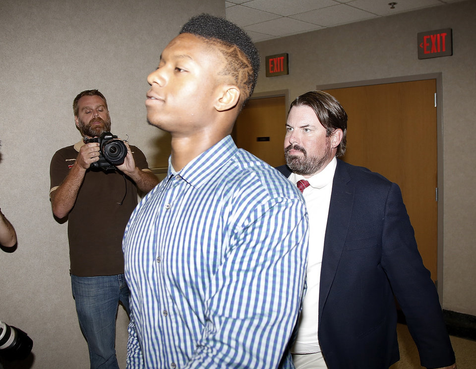 Photo - University of Oklahoma freshman Joe Mixon and his attorneys walk into Judge Steve Stice's courtroom in Cleveland County  in Norman, Monday  August  18, 2014. Photo By Steve Gooch, The Oklahoman