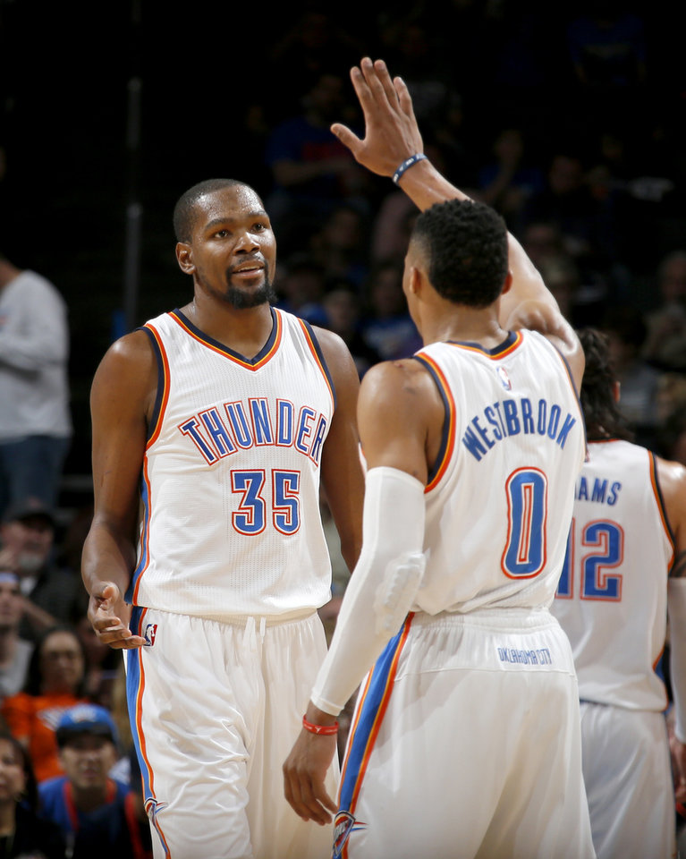 Photo - Oklahoma City's Kevin Durant (35) slaps hands with Russell Westbrook (0) during an NBA basketball game between the Oklahoma City Thunder and the Houston Rockets at Chesapeake Energy Arena in Oklahoma City, Friday, Jan. 29, 2016. Oklahoma City won 116-108. Photo by Bryan Terry, The Oklahoman