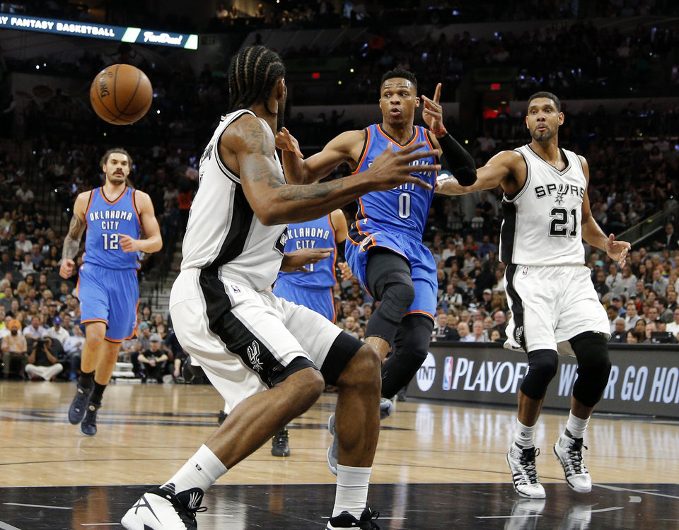 Photo - Oklahoma City's Russell Westbrook (0) passes around San Antonio's Kawhi Leonard (2) during Game 5 of the second-round series between the Oklahoma City Thunder and the San Antonio Spurs in the NBA playoffs at the AT&T Center in San Antonio, Tuesday, May 10, 2016. Photo by Bryan Terry, The Oklahoman