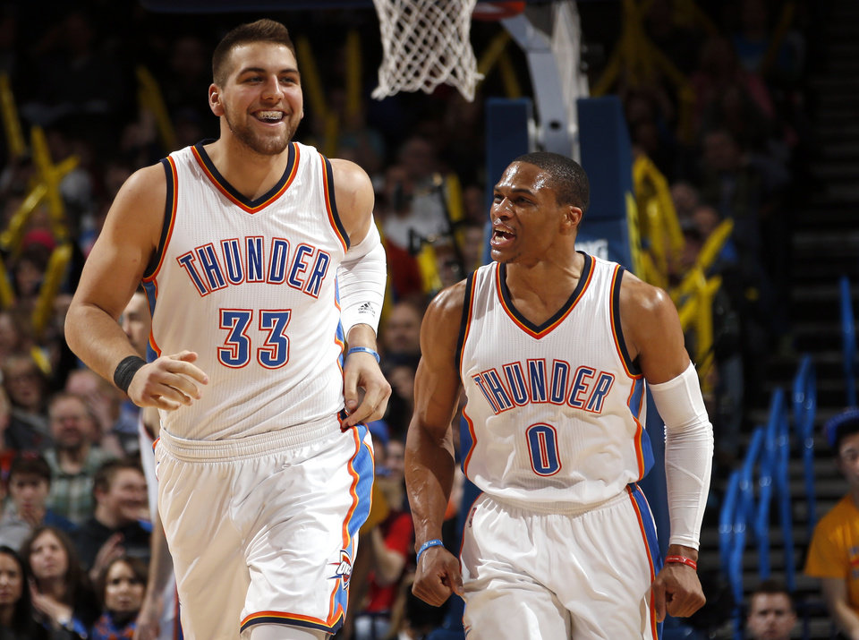 Photo - Oklahoma City's Mitch McGary and Oklahoma City's Russell Westbrook (0) celebrate a defensive play during the NBA game between the Oklahoma City Thunder and the Denver Nuggets at Chesapeake Energy Arena in Oklahoma City, Sunday, Feb. 22, 2015. Photo by Sarah Phipps, The Oklahoman