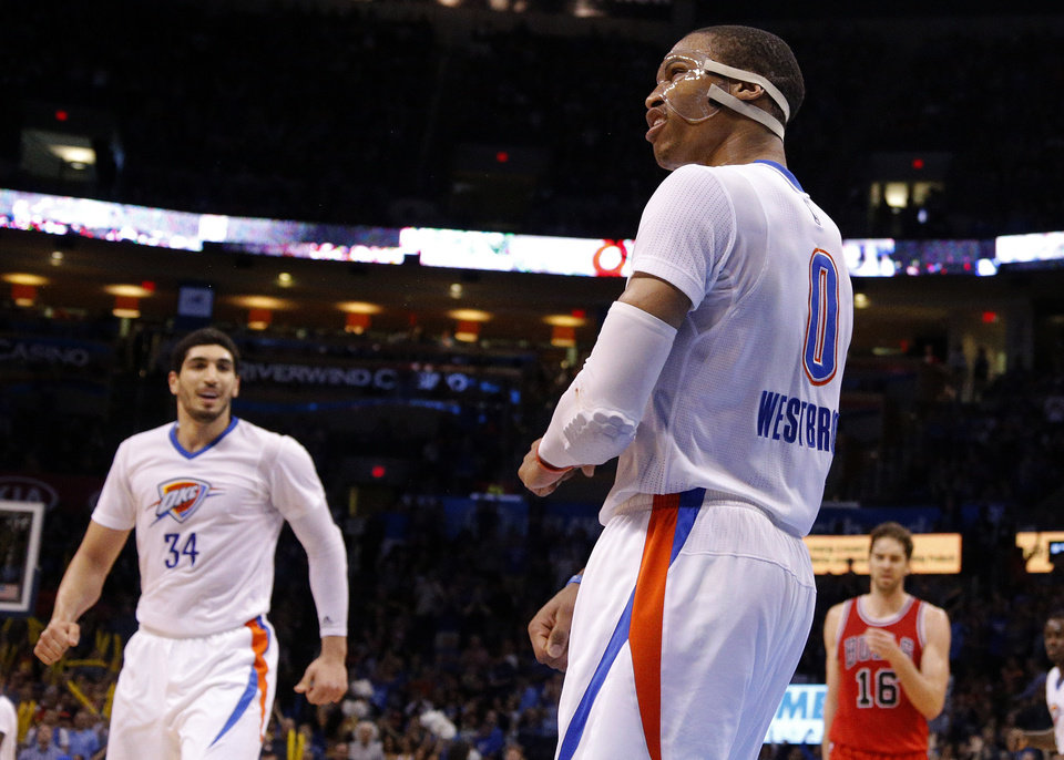 Photo - Russell Westbrook (0) celebrates during the NBA game between the Oklahoma City Thunder and the Chicago Bulls at Chesapeake Energy Arena in Oklahoma City, Sunday, March  15, 2015. Photo by Sarah Phipps, The Oklahoman
