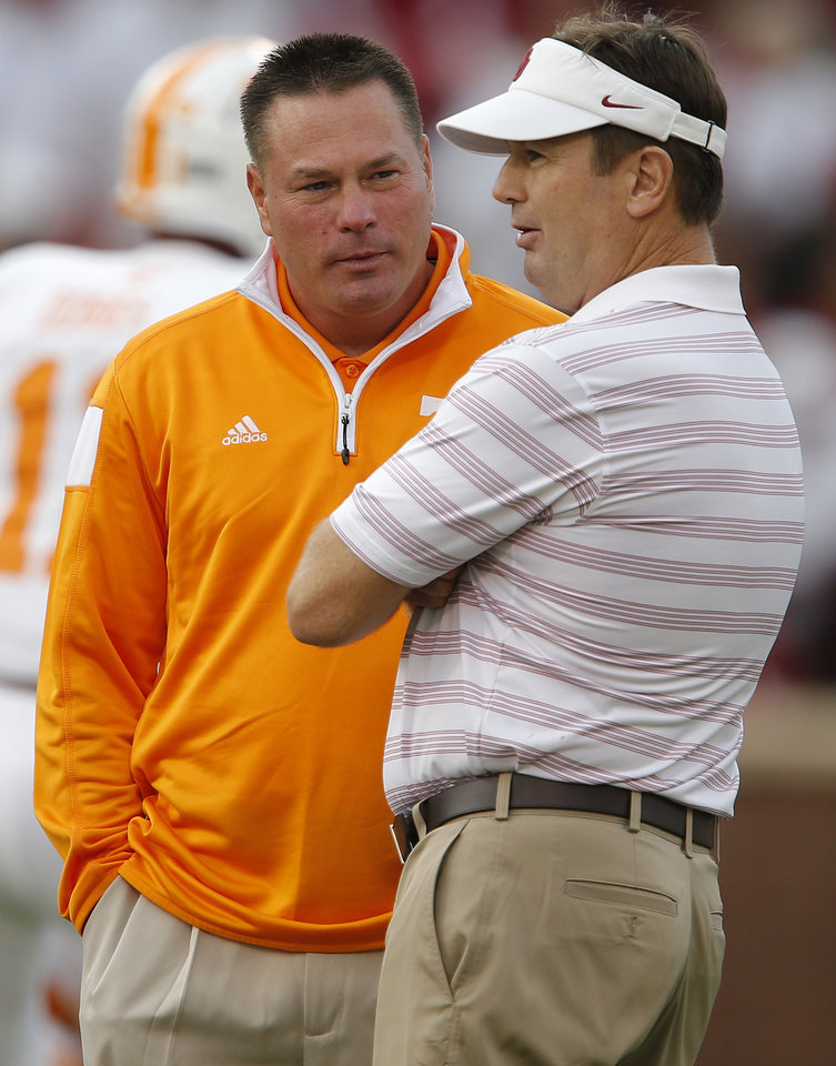 Photo - Tennessee coach Butch Jones talks with Oklahoma coach Bob Stoops before a college football game between the University of Oklahoma Sooners (OU) and the Tennessee Volunteers at Gaylord Family-Oklahoma Memorial Stadium in Norman, Okla., on Saturday, Sept. 13, 2014. Photo by Bryan Terry, The Oklahoman