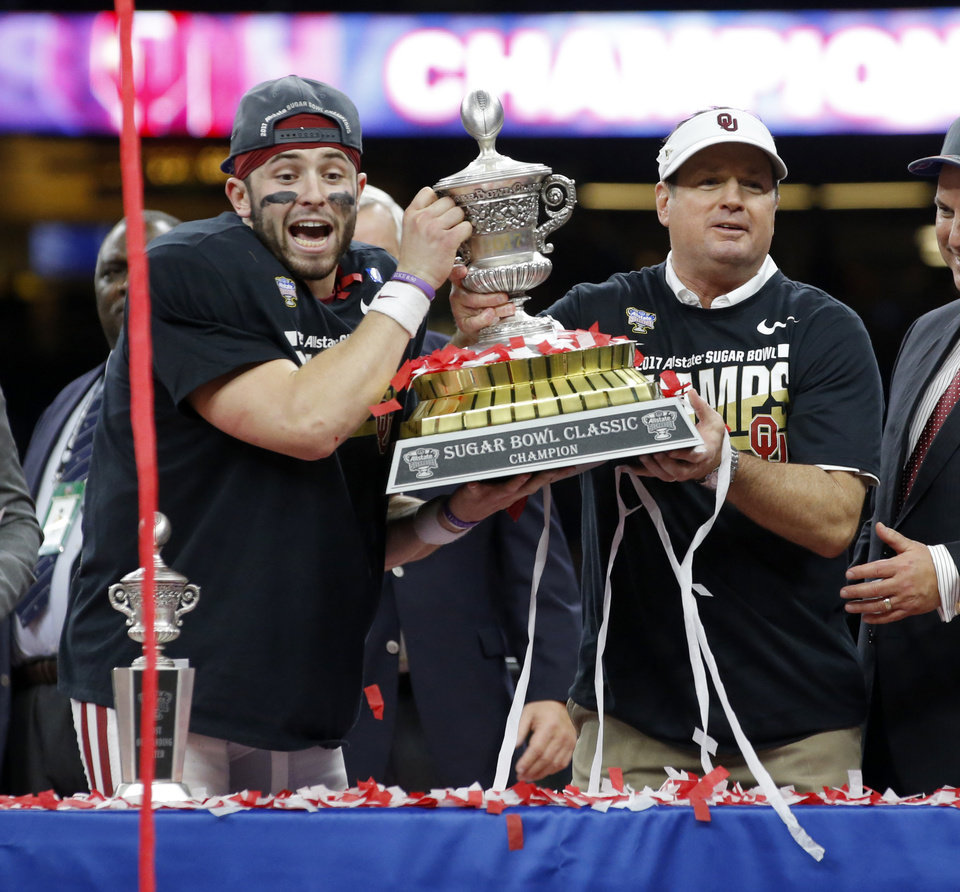 Photo -  Oklahoma's Baker Mayfield and coach Bob Stoops celebrate with the trophy after the Allstate Sugar Bowl between the University of Oklahoma Sooners and the Auburn University Tigers at the Mercedes-Benz Superdome in New Orleans. [Photos by Bryan Terry, The Oklahoman]
