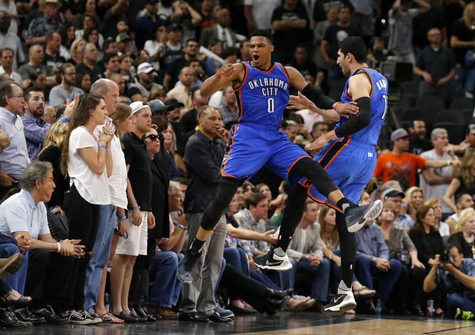 Photo - Oklahoma City's Russell Westbrook (0) and Enes Kanter (11) celebrate late during Game 5 of the second-round series between the Oklahoma City Thunder and the San Antonio Spurs in the NBA playoffs at the AT&T Center in San Antonio, Tuesday, May 10, 2016. Oklahoma City won 95-91. Photo by Bryan Terry, The Oklahoman