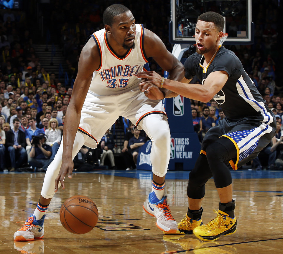... Photo - Oklahoma City\u0027s Kevin Durant (35) works against Golden State\u0027s Stephen  Curry (
