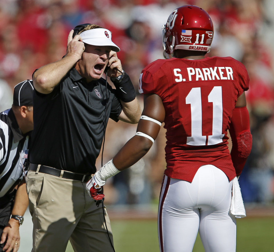Photo - Oklahoma defensive coordinator Mike Stoops shouts at Oklahoma's Steven Parker (11) during a college football game between the University of Oklahoma Sooners (OU) and the Kansas State University Wildcats at Gaylord Family-Memorial Stadium on Saturday, Oct. 18, 2014. Oklahoma lost 31-30. Photo by Bryan Terry, The Oklahoman