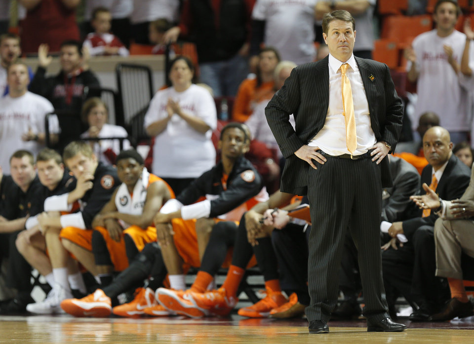 Photo - OSU coach Travis Ford stands near the bench late in the second half during the NCAA men's Bedlam basketball game between the Oklahoma State Cowboys (OSU) and the Oklahoma Sooners (OU) at Lloyd Noble Center in Norman, Okla., Monday, Jan. 27, 2014. OU won, 88-76. Photo by Nate Billings, The Oklahoman