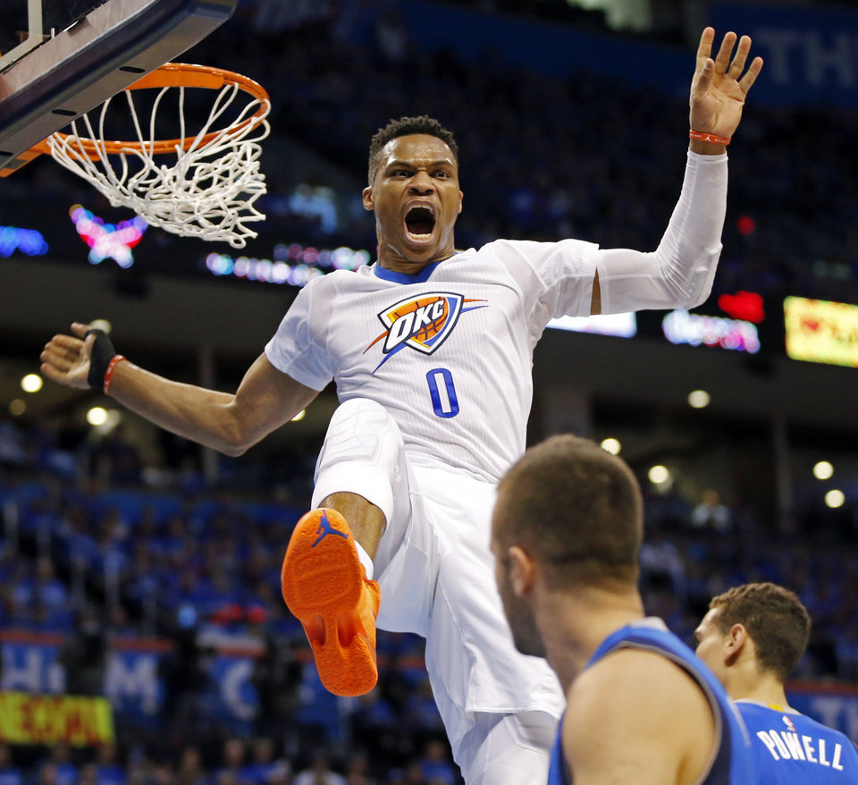 Photo - Oklahoma City's Russell Westbrook (0) reacts after a dunk during Game 5 of the first round series between the Oklahoma City Thunder and the Dallas Mavericks in the NBA playoffs at Chesapeake Energy Arena in Oklahoma City, Monday, April 25, 2016. Photo by Nate Billings, The Oklahoman