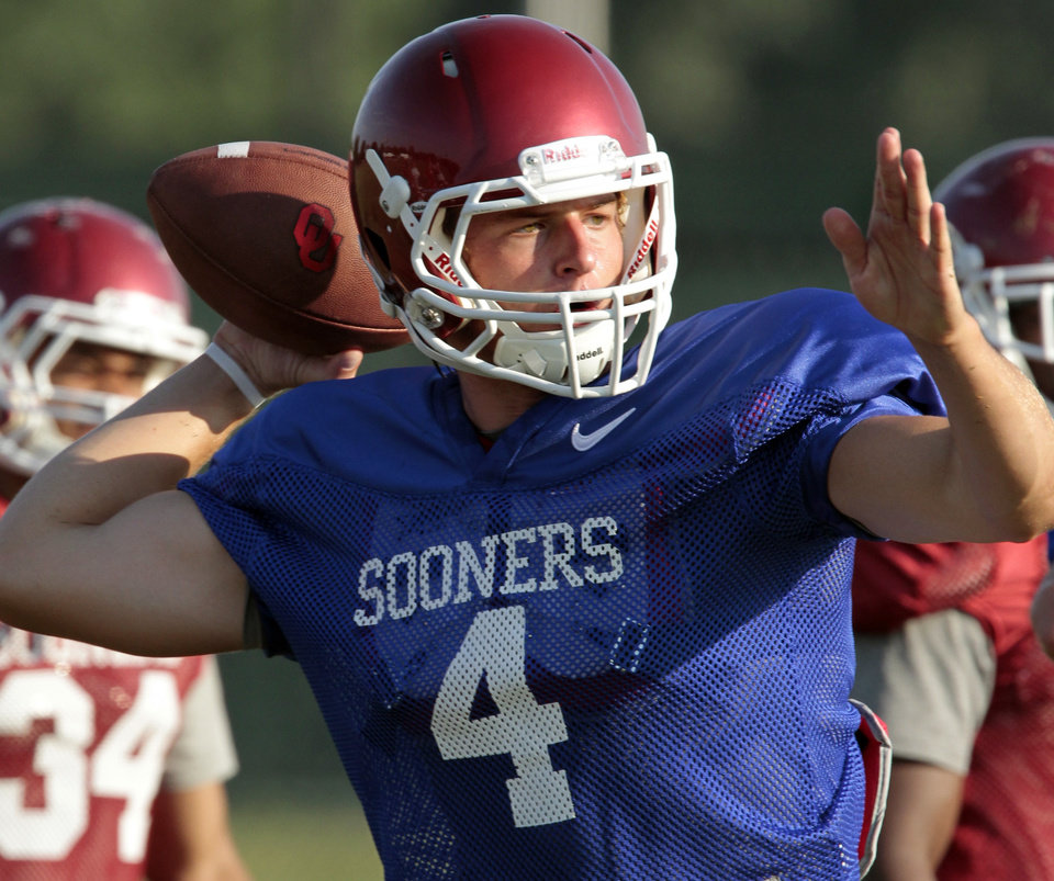 Photo -  Quarterback Justice Hansen goes through drills during the University of Oklahoma Sooners (OU) football practice at the rugby fields in Norman, Okla., on Tuesday, Aug. 5, 2014. Photo by Steve Sisney, The Oklahoman