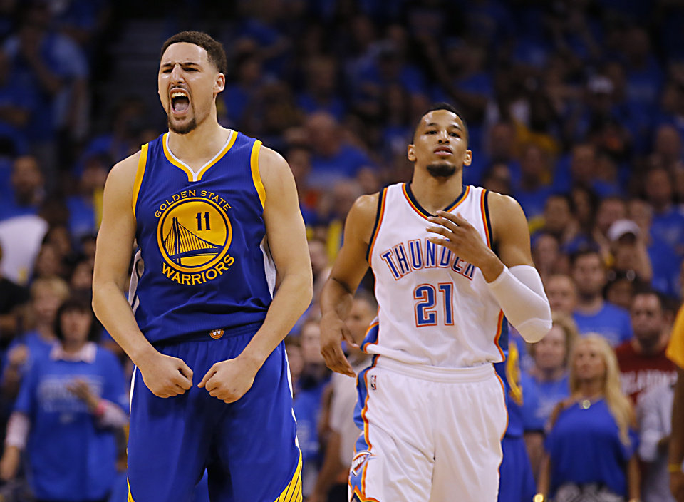 Photo - Golden State's Klay Thompson (11) reacts in front of Oklahoma City's Andre Roberson (21) late in the 4th quarter during Game 6 of the Western Conference finals in the NBA playoffs between the Oklahoma City Thunder and the Golden State Warriors at Chesapeake Energy Arena in Oklahoma City, Saturday, May 28, 2016. Photo by Sarah Phipps, The Oklahoman
