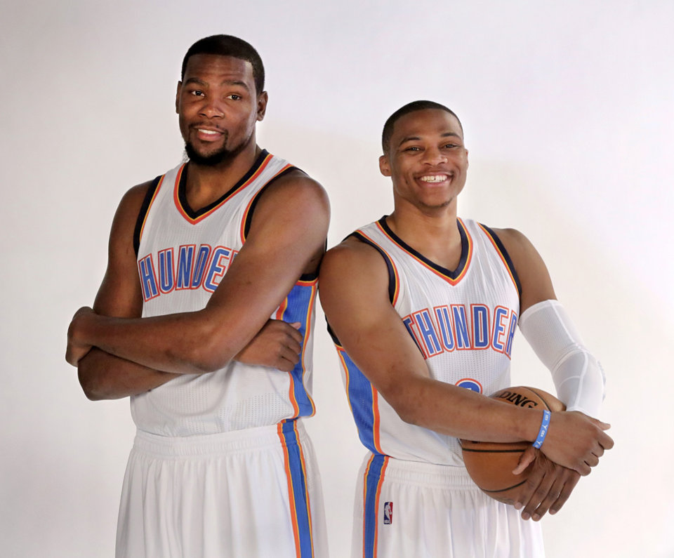 Photo - Teammates Kevin Durant, left, and Russell Westbrook pose for photographers during OKC Thunder Media Day in Chesapeake Arena on Monday, Sep. 29, 2014. Photo by Jim Beckel, The Oklahoman