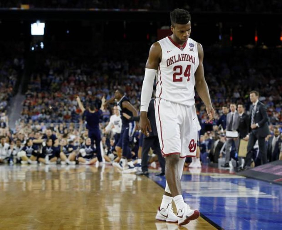 Photo - Oklahoma's Buddy Hield (24) walks off the court late in the second half of the national semifinal between the Oklahoma Sooners (OU) and the Villanova Wildcats in the Final Four of the NCAA Men's Basketball Championship at NRG Stadium in Houston, Saturday, April 2, 2016. Photo by Nate Billings, The Oklahoman