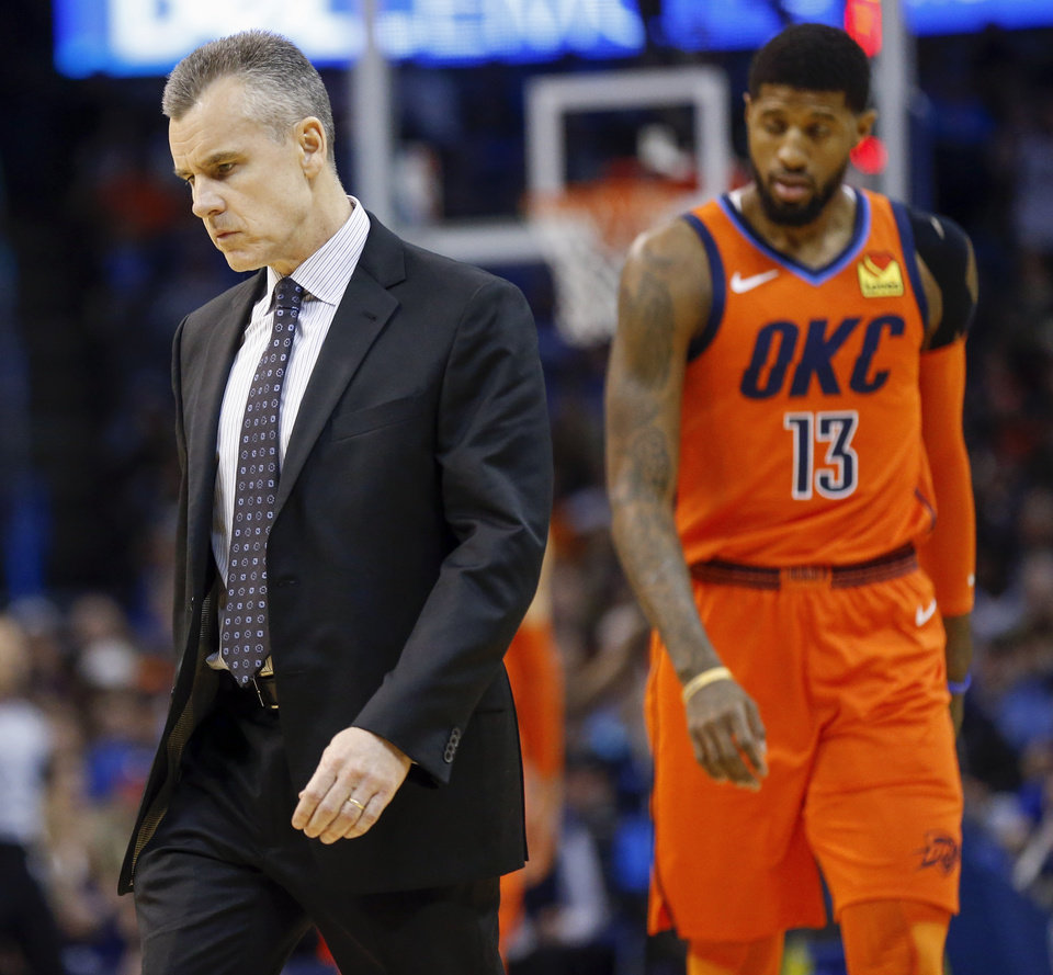 Photo - Oklahoma City head coach Billy Donovan walks on the court as Paul George (13) heads to the bench during a timeout in the first quarter of an NBA basketball game between the Dallas Mavericks and the Oklahoma City Thunder at Chesapeake Energy Arena in Oklahoma City, Sunday, March 31, 2019. Photo by Nate Billings, The Oklahoman